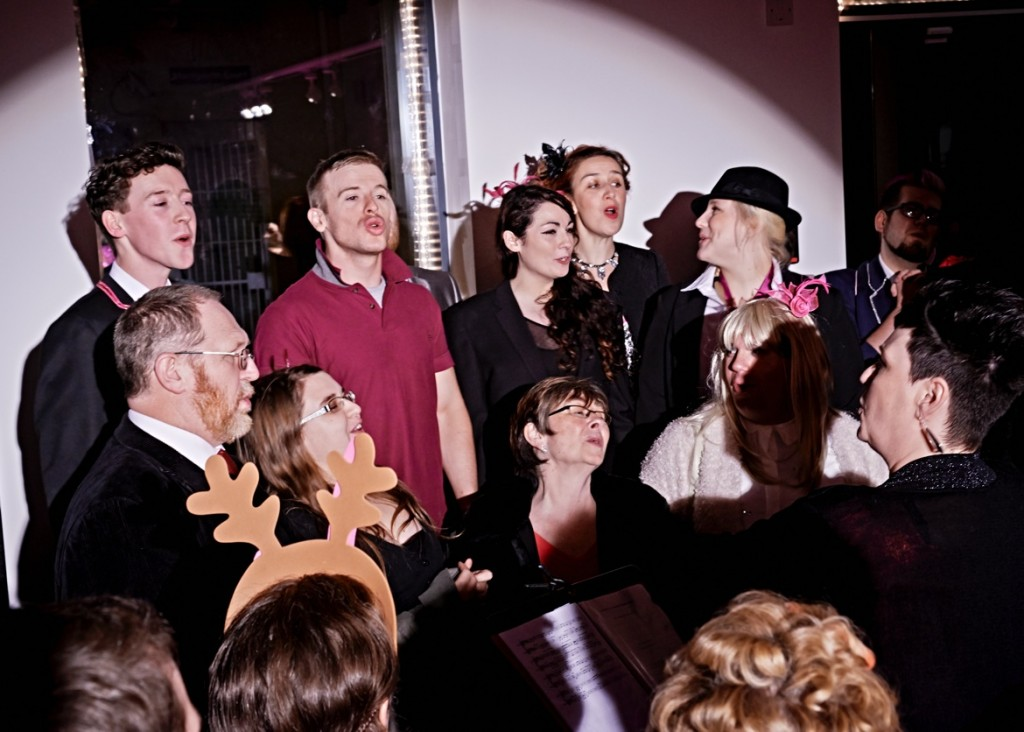 The cast of Queer Christmas sing