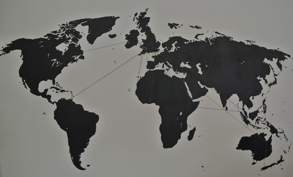 A map of the world with wool threads indicating where visitors have come from
