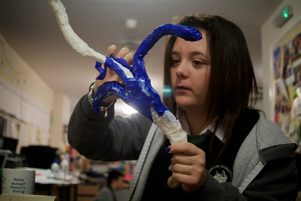 Young person painting reindeer antlers
