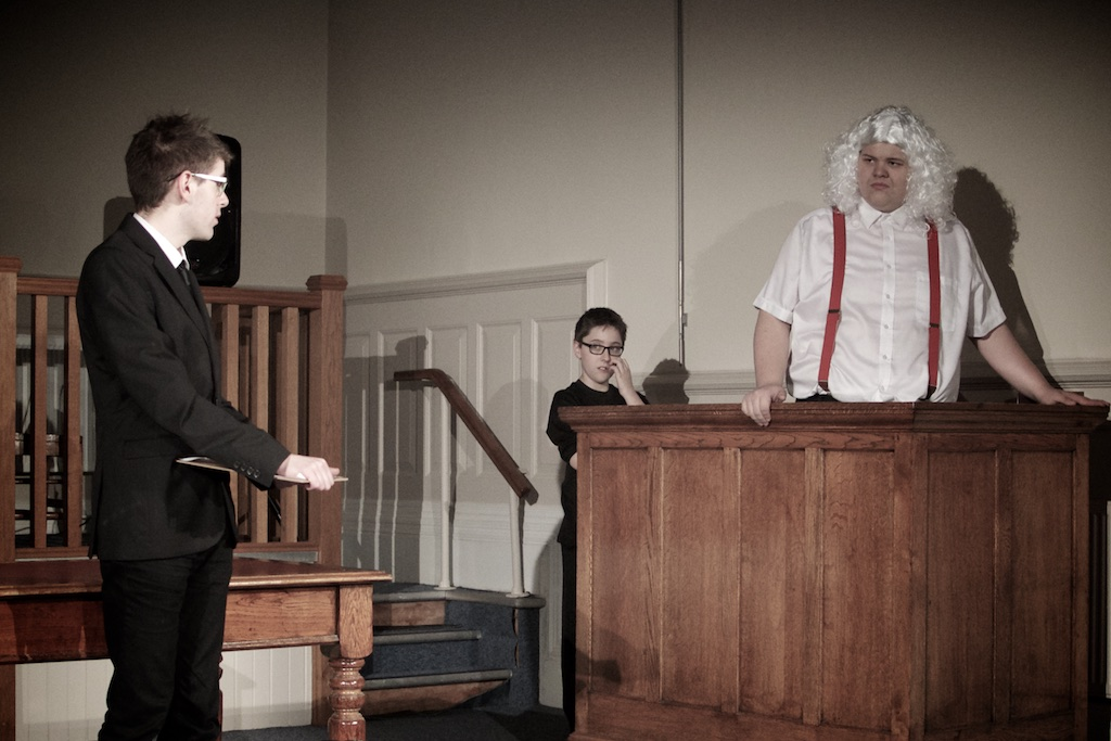 Father Christmas in the dock of a courtroom being cross examined by a prosecutor