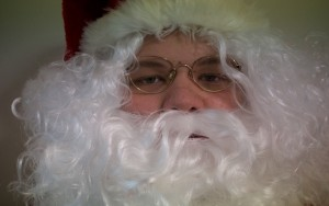 Father Christmas in full beard and glasses
