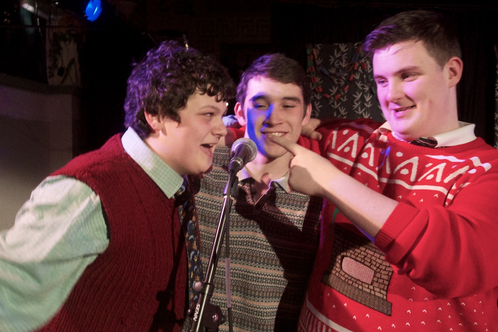 Three performers sing