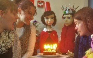 Staff and Ken and Bee puppets celebrate our tenth birthday with cake and candles